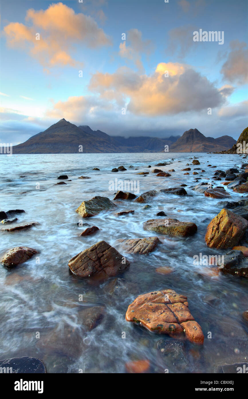 The Black Cuillin Hills on the Isle of Skye captured shortly before sunset from rocks near Elgol - Stock Image