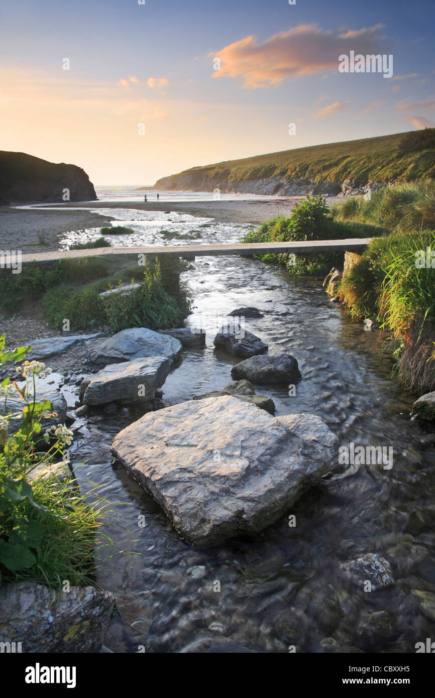 Porth/Polly Joke beach in Cornwall captured shortly before sunset - Stock Image