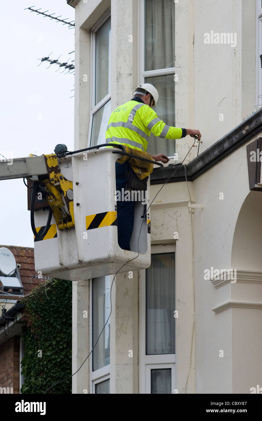 Rewiring Stock Photos Images Alamy Rewire Old House Wiring Telephone Engineer At Work Cables After Replacing Chandelier Style Pole Image