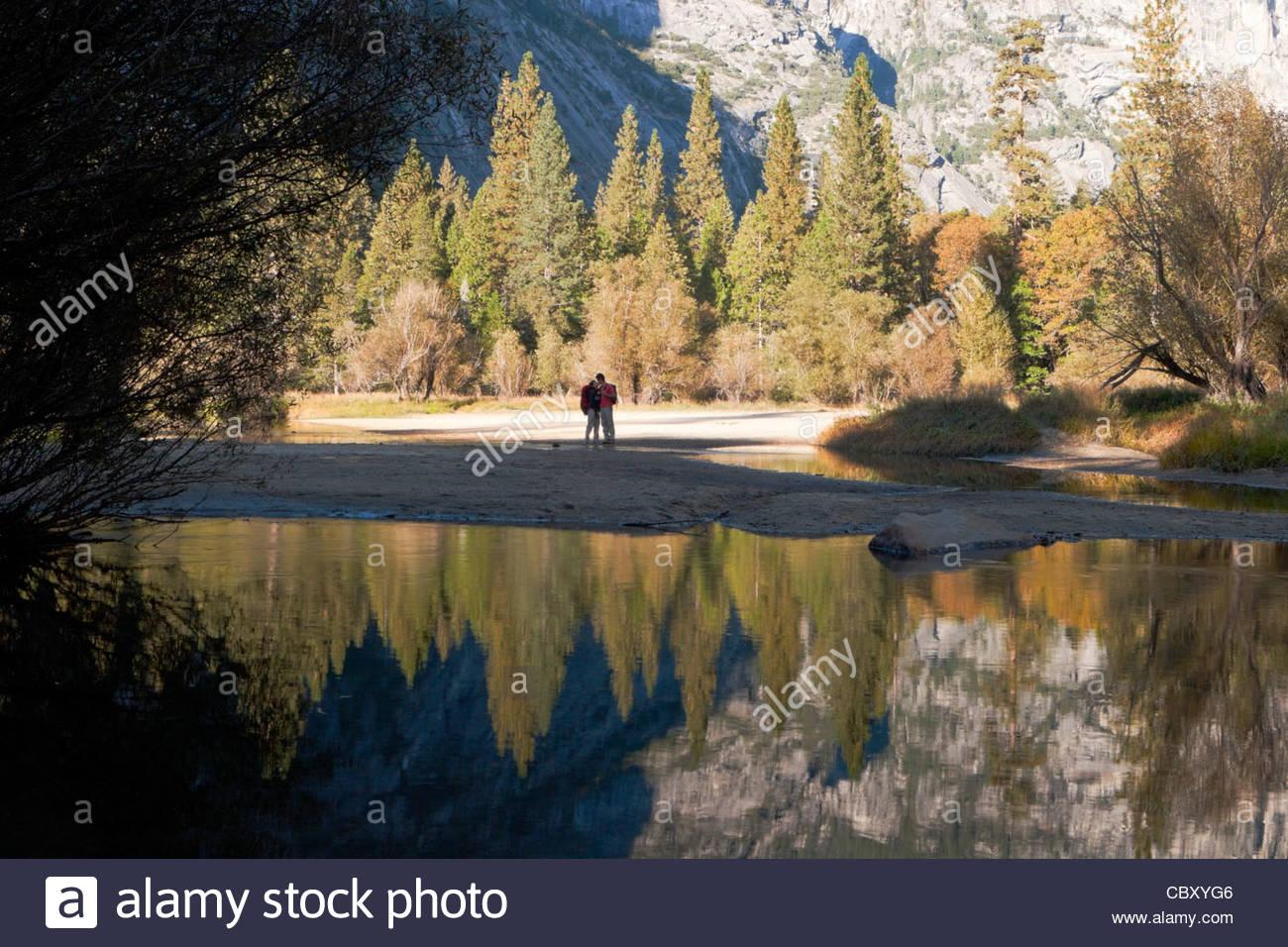 Lovers Kissing on Shoreline of Mirror Lake, Yosemite National Park, California - Stock Image