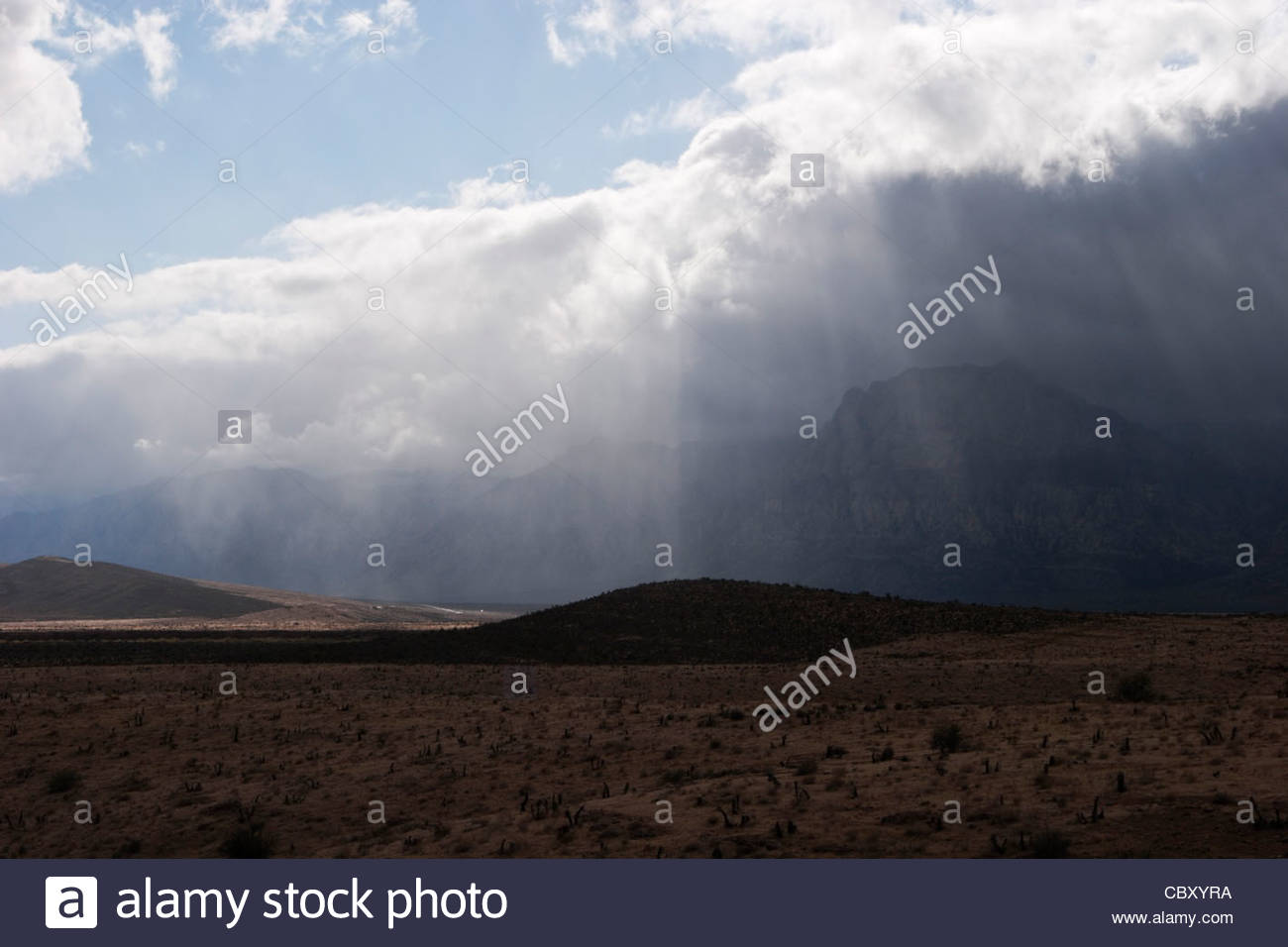 God Beams and Rain Clouds, Red Rock Canyon National Conservation Area, Nevada - Stock Image
