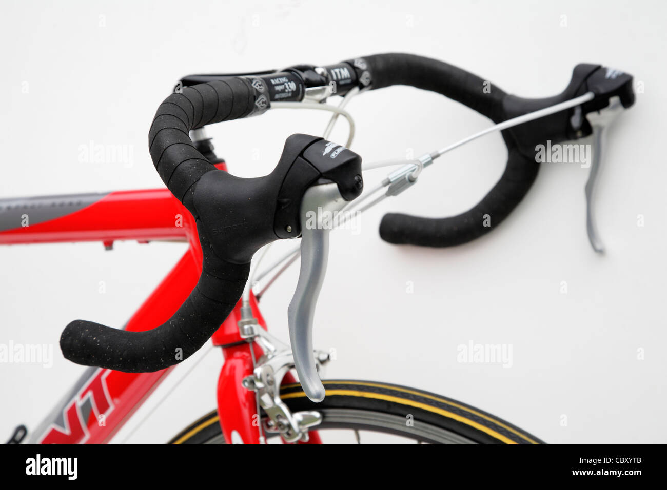 close up detail of a racing bike brake levers drop handlebars - Stock Image