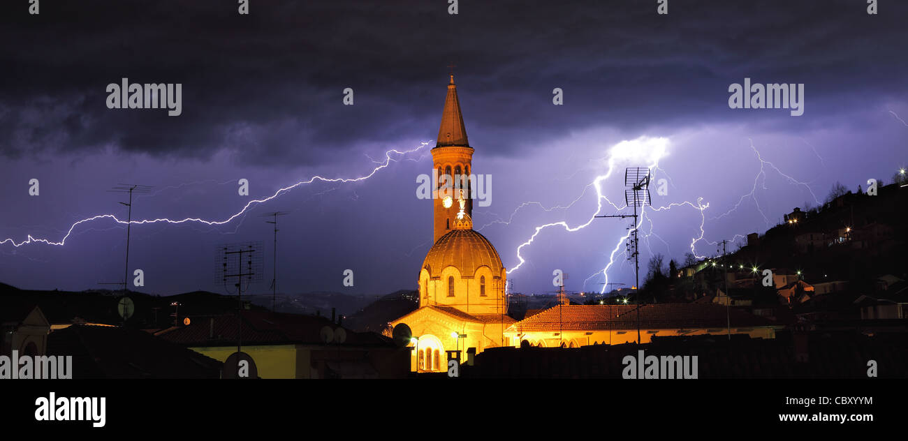 Panoramic view on lightning over Alba and surrounding hills during thunderstorm in northern Italy. Stock Photo