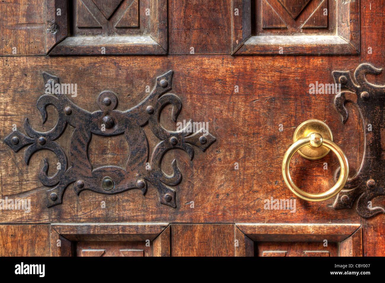 Fragment Of Vintage Wooden Door With Ornament And Round Golden Doorhandle.    Stock Image