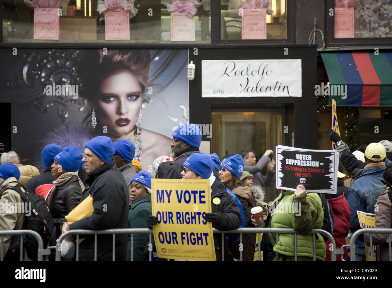 Union members in NYC march and demonstrate against the Koch Brothers payed influence on the manipulation of voting - Stock Image