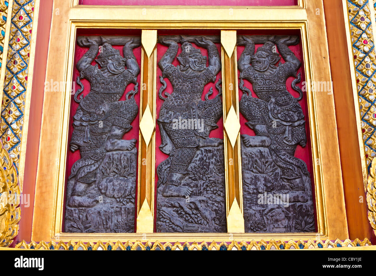 Native Thai style wood carving on window in temple, bangkok Thailand. - Stock Image