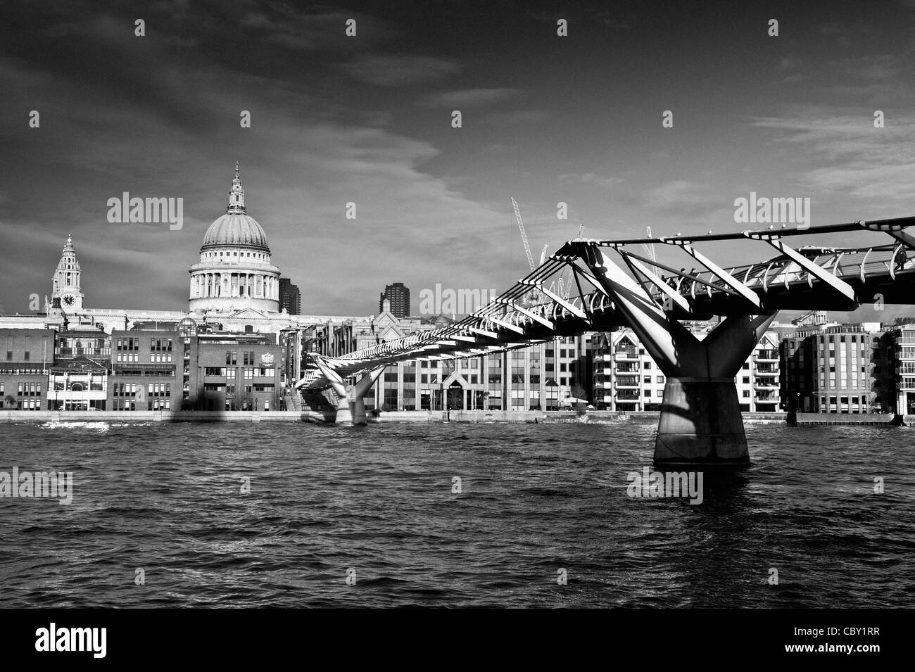 St Paul's Cathedral and the Millennium bridge over the river Thames, London. - Stock Image