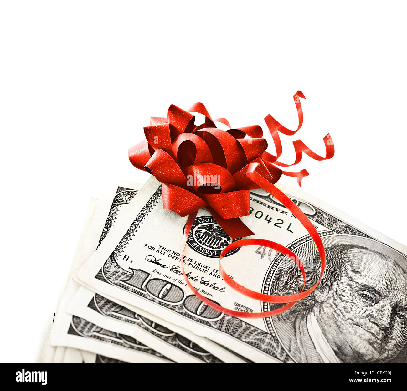 Money, gift wrapped in red bow and ribbon, one hundred dollars banknotes, US currency as cash isolated on white - Stock Image