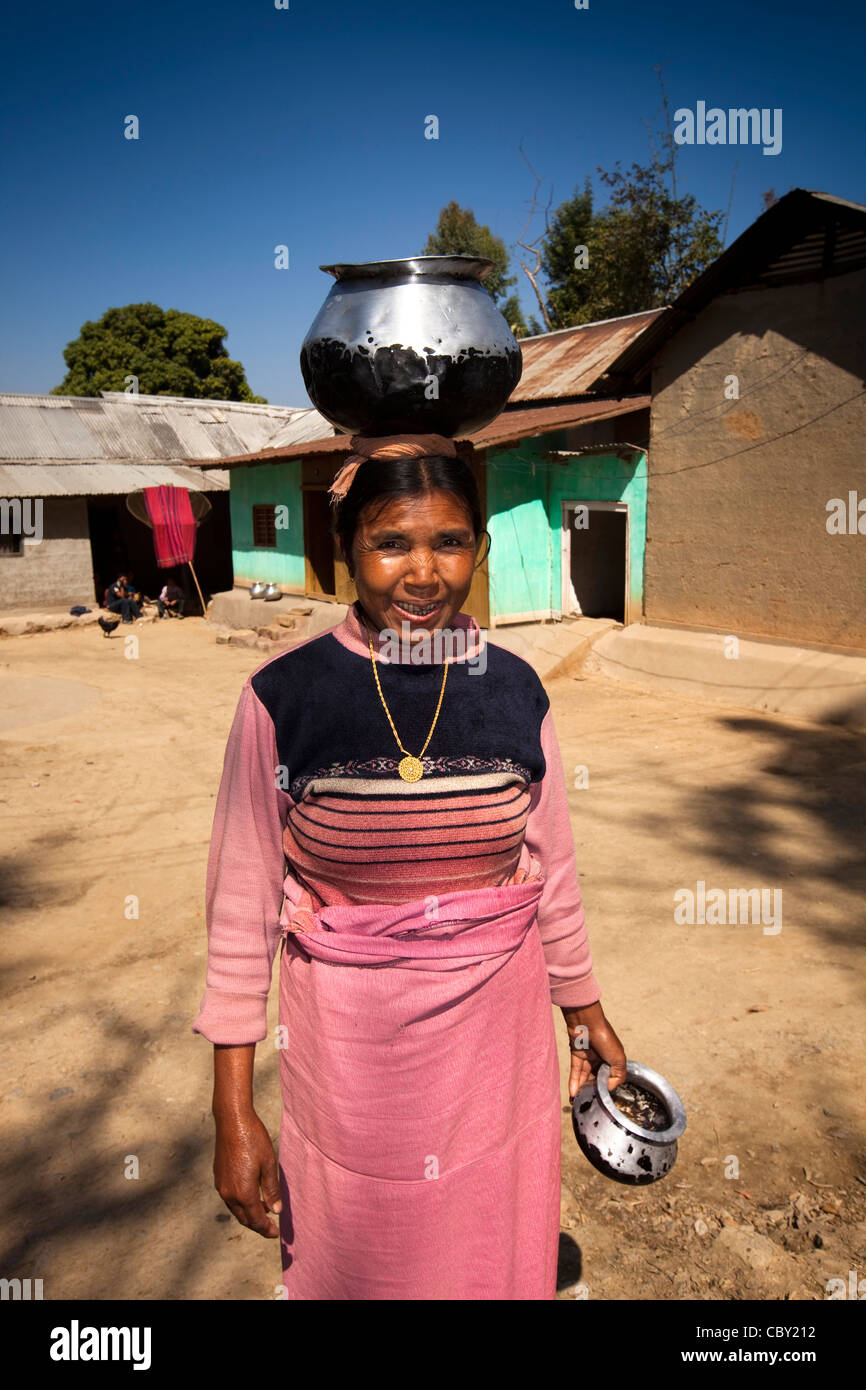 India, Manipur, Imphal, Loktak Lake, Sendra Island, Manipuri woman with water pot on head - Stock Image