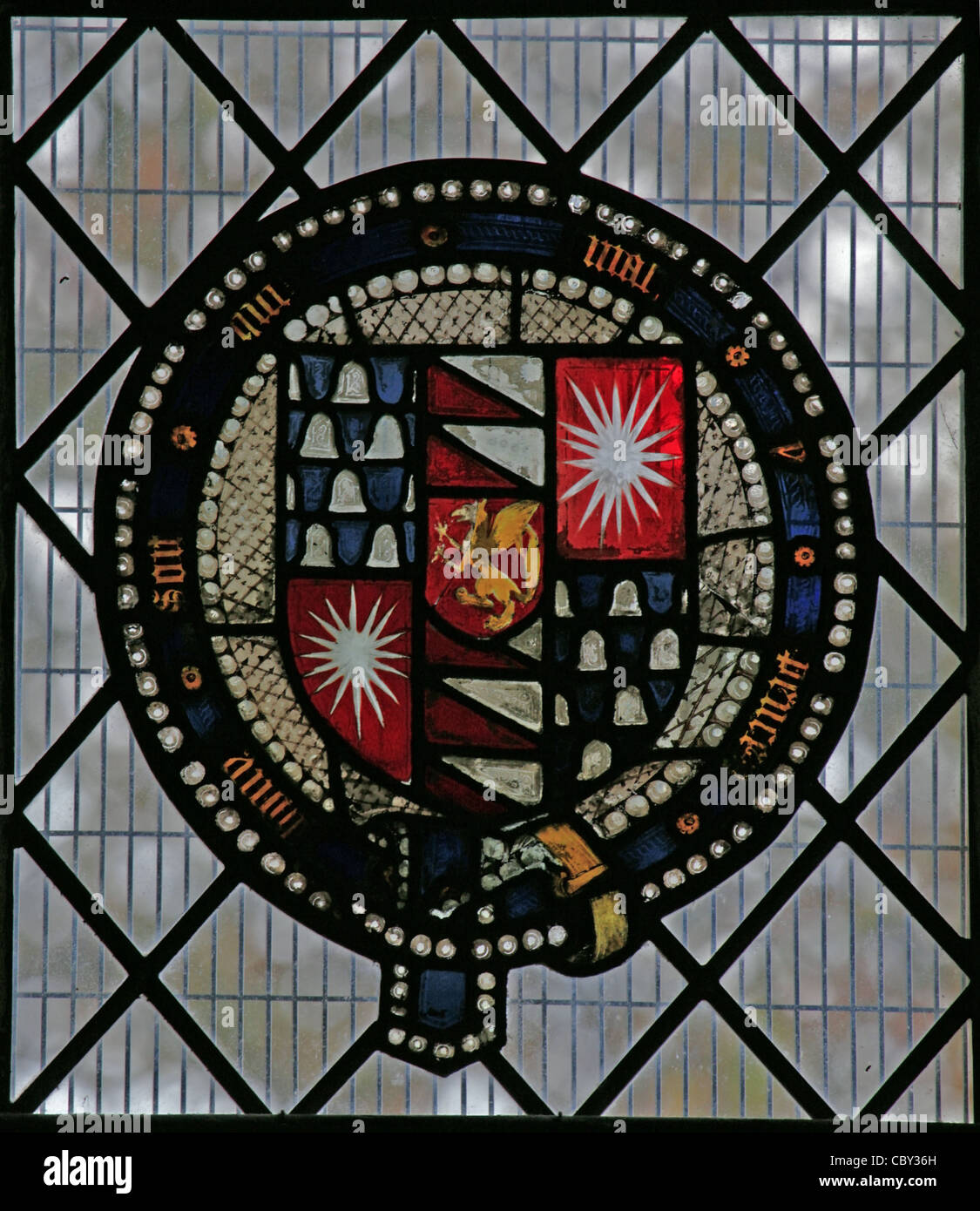 A stained glass window depicting heraldic shields, St Peter & St Paul Church, Charing, Kent - Stock Image
