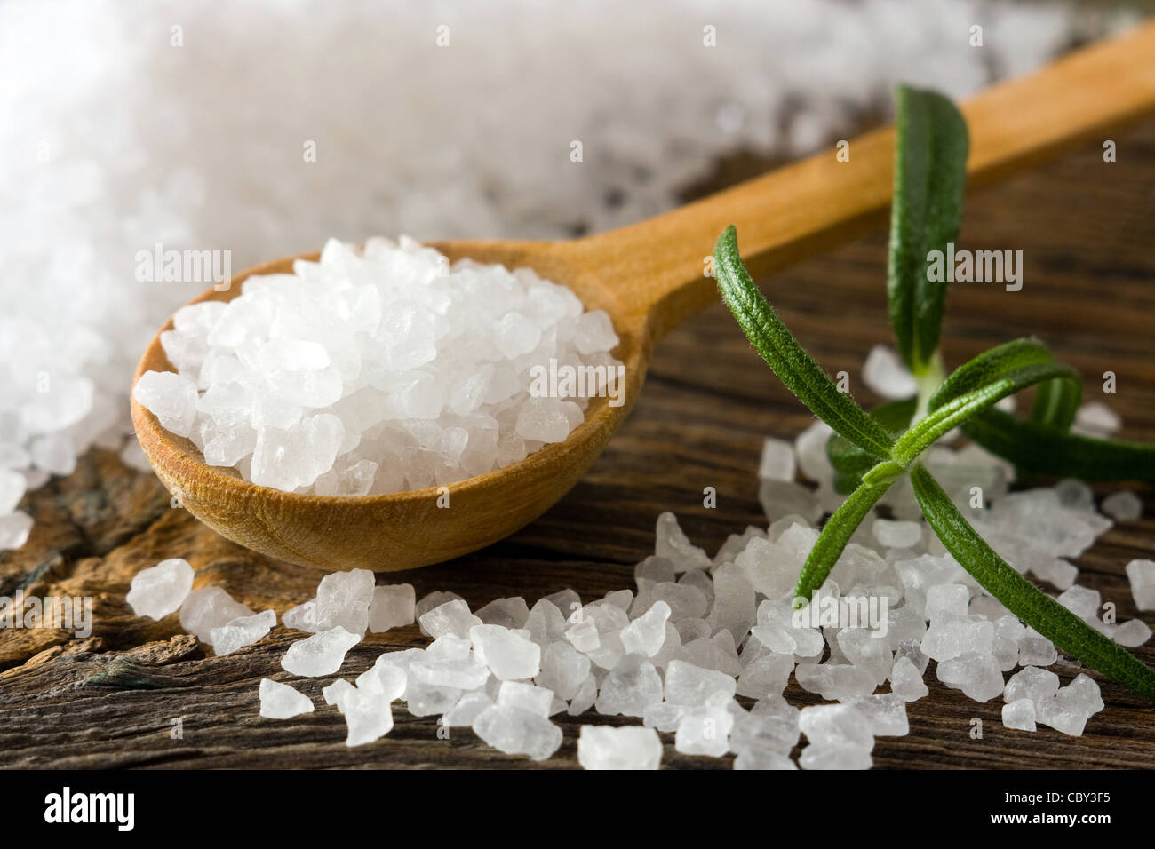 Sea salt on wooden spoon - Stock Image