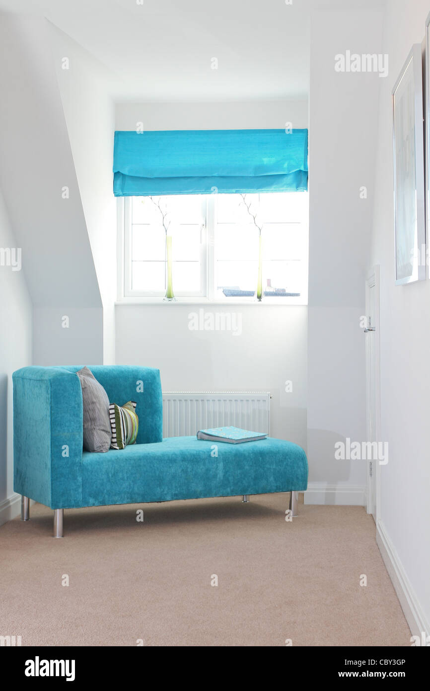 modern chez lounge in an attic bedroom window - Stock Image