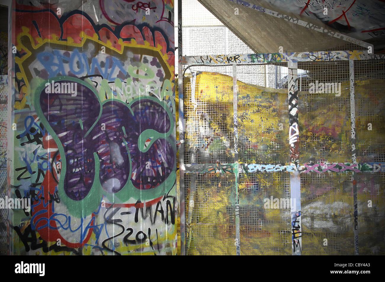 Vibrant graffiti on concrete wall on south bank of river thames central london graffiti