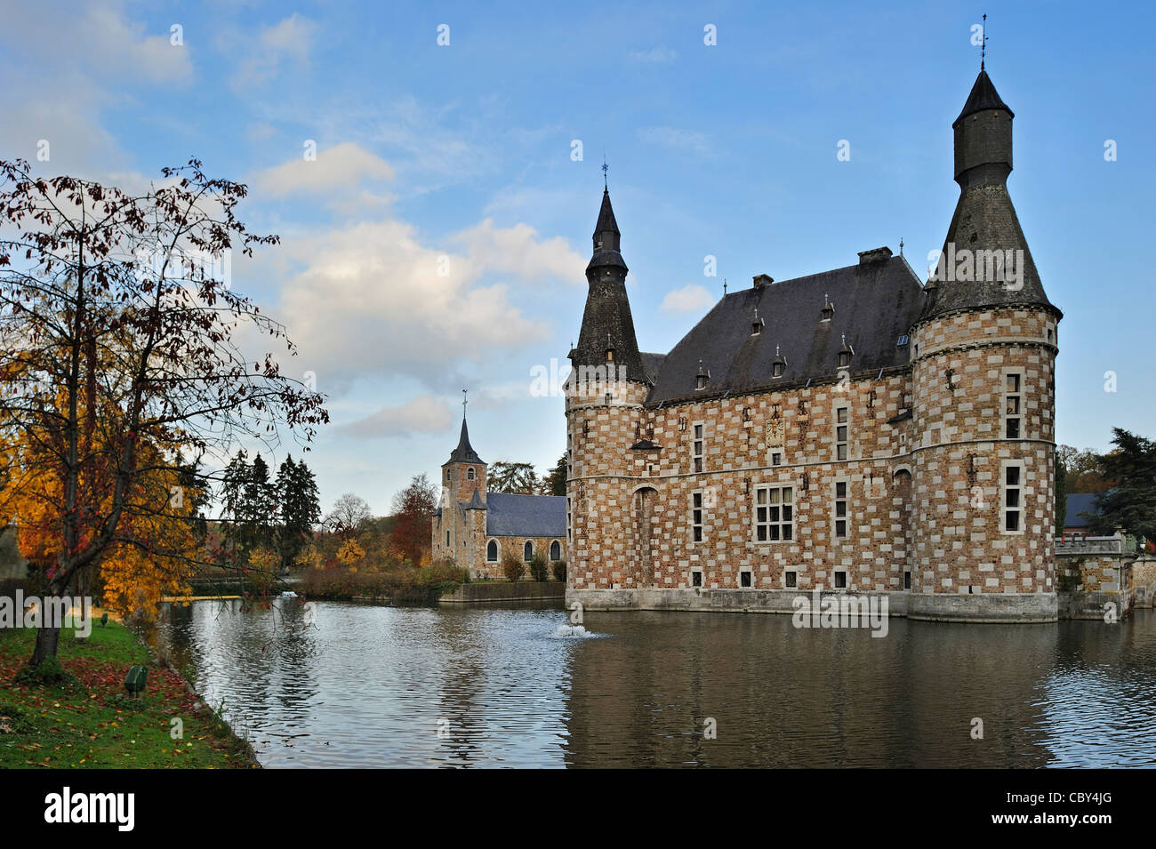 Castle Jehay with checkerboard façade in autumn, Belgium - Stock Image