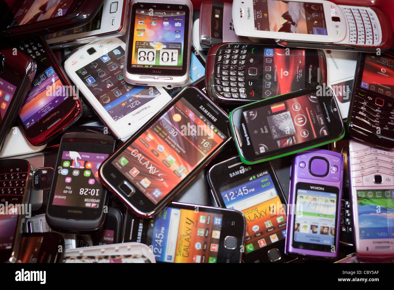 Pile Of Cell Phones : Pile of mobile phones stock photo alamy