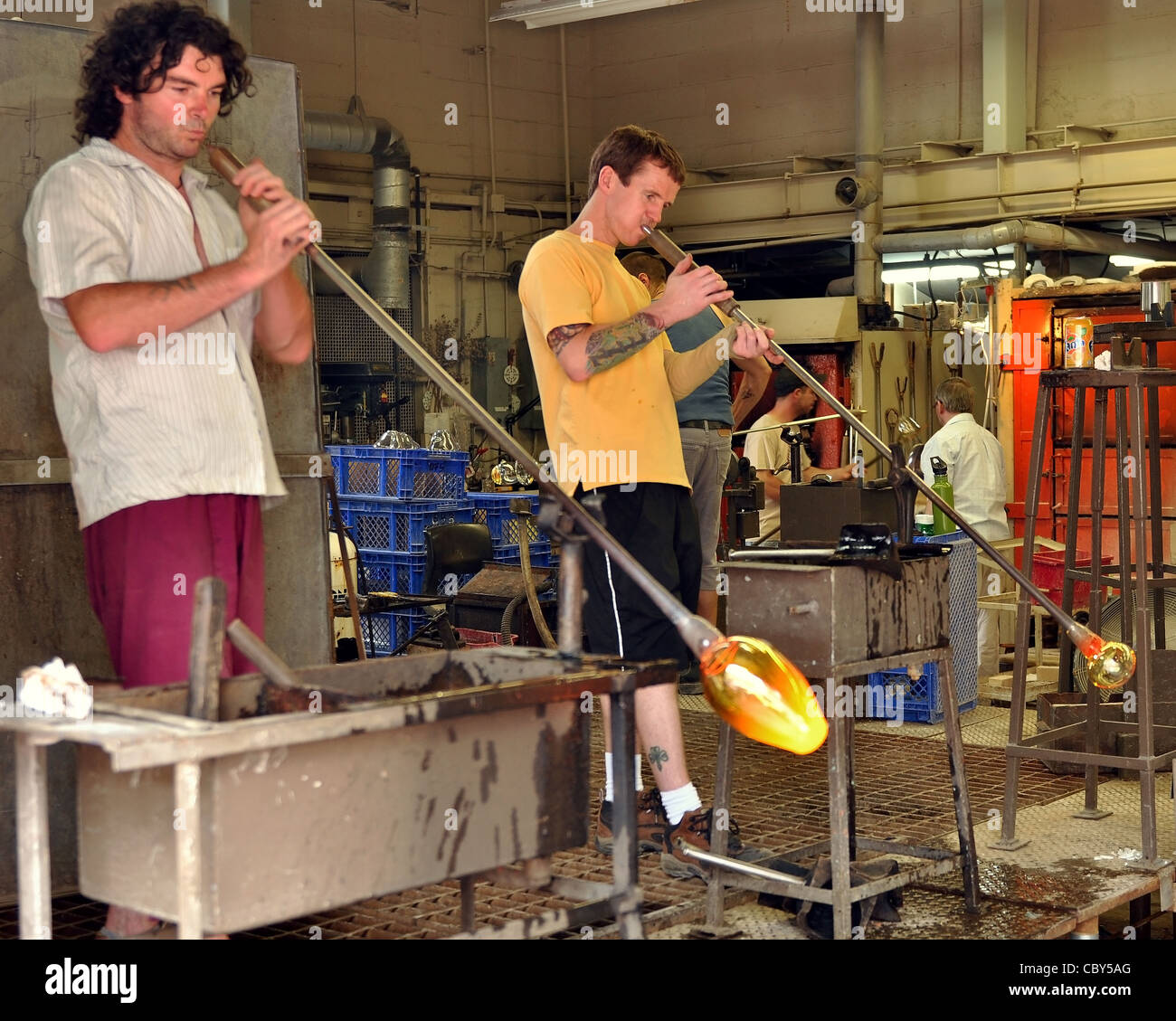 Glass blowers demonstrate their craft for tourists on the historic properties July 26, 2010 in Halifax, Nova Scotia - Stock Image