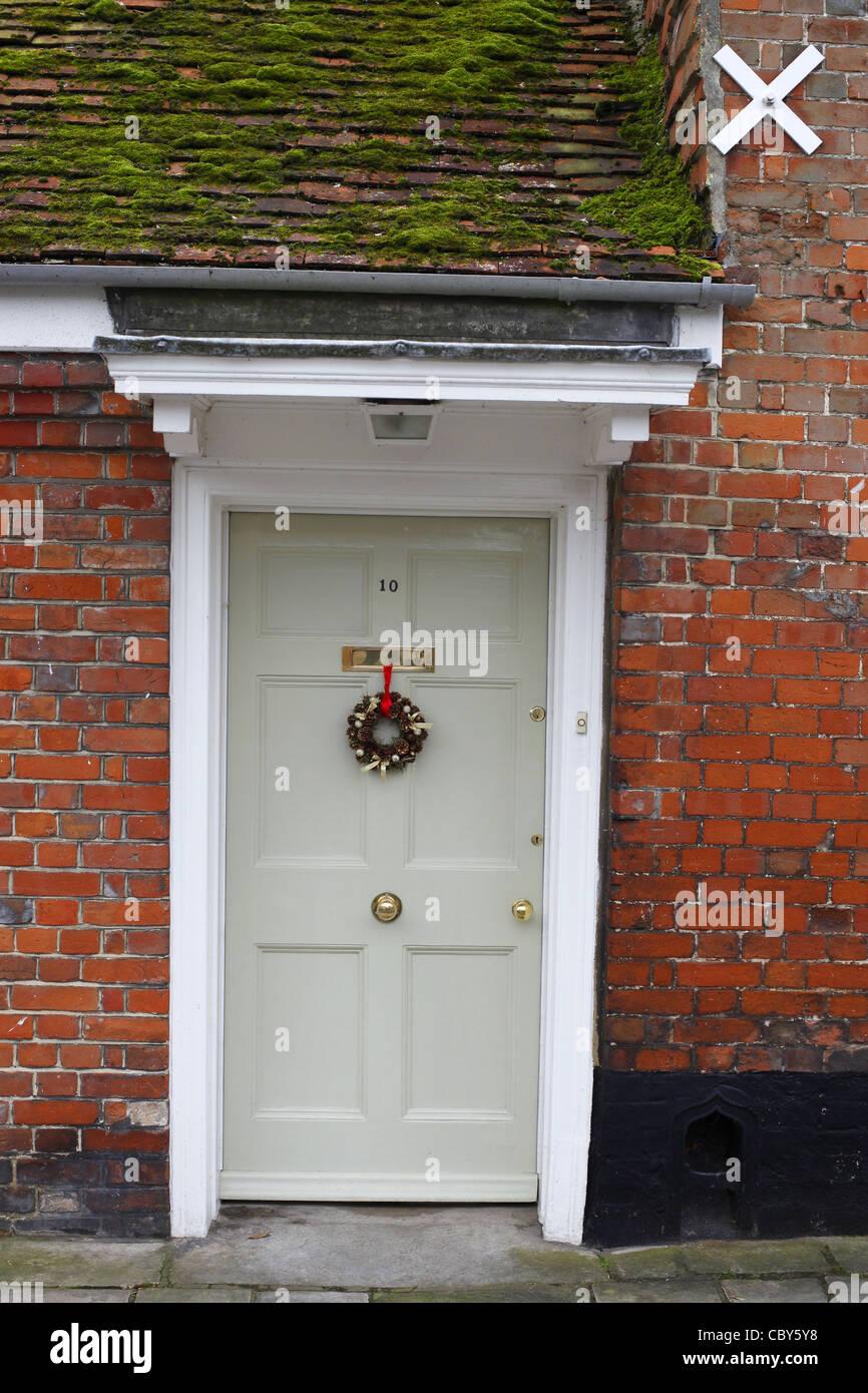 front door with Christmas wreath. Stock Photo