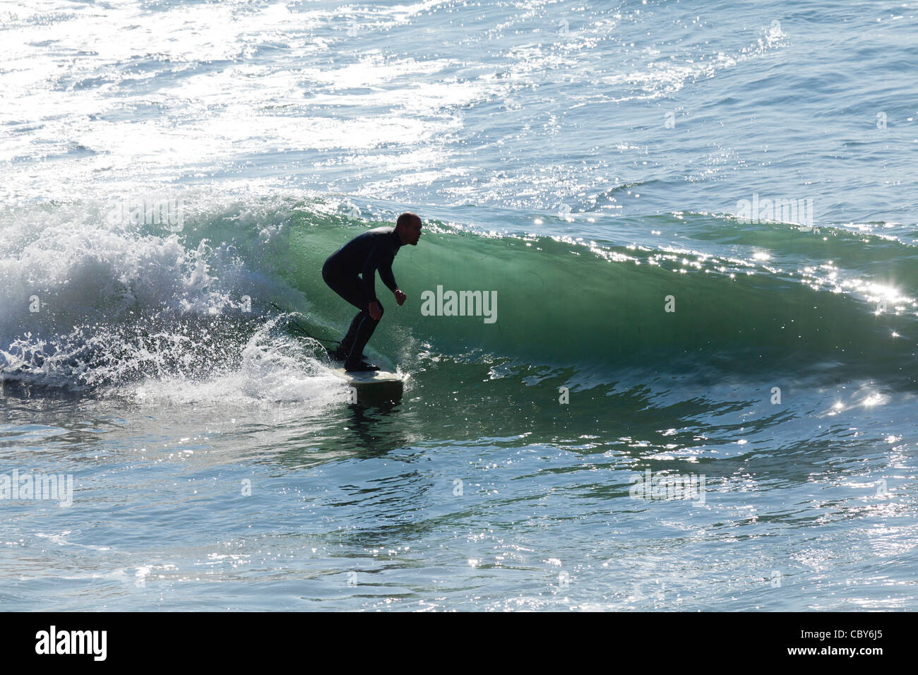 Surfer catches a wave during the annual ONeill Surfing Contest on the Pacific Ocean near Waddell Creek and Santa - Stock Image