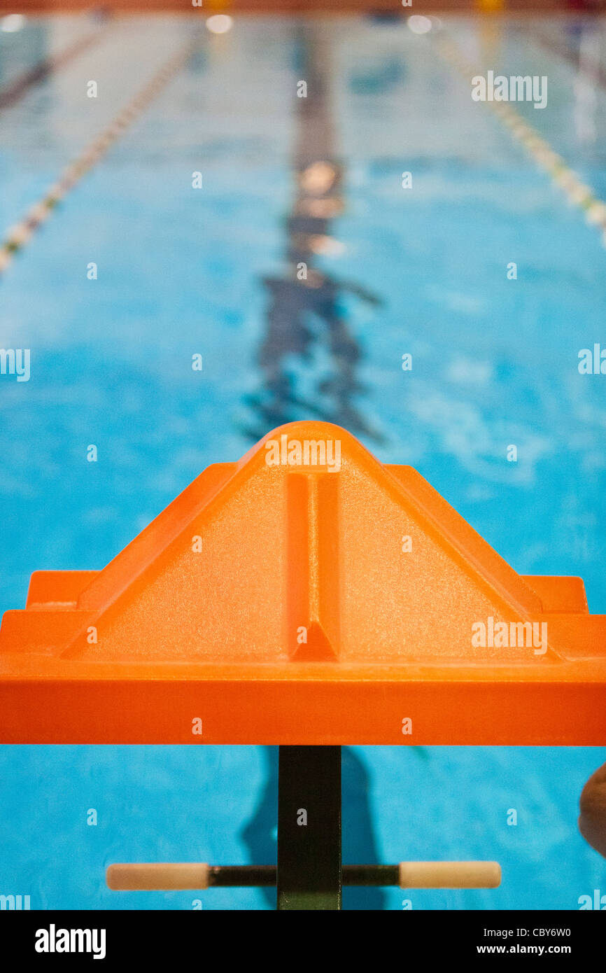Orange swimmers starting platform - Stock Image