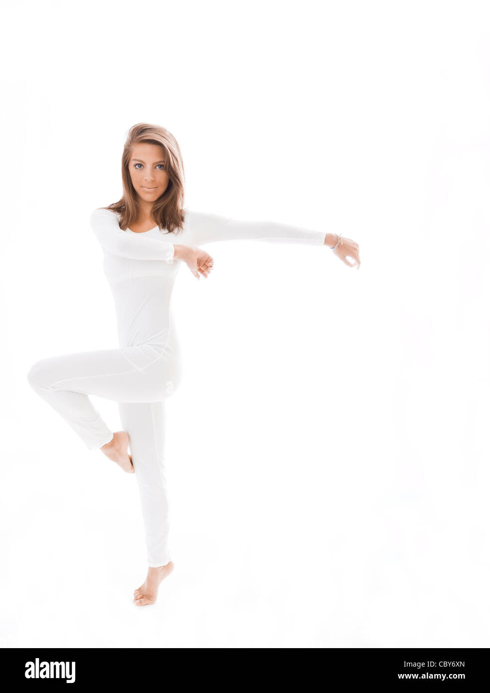 Young dancer in white against a white background - Stock Image