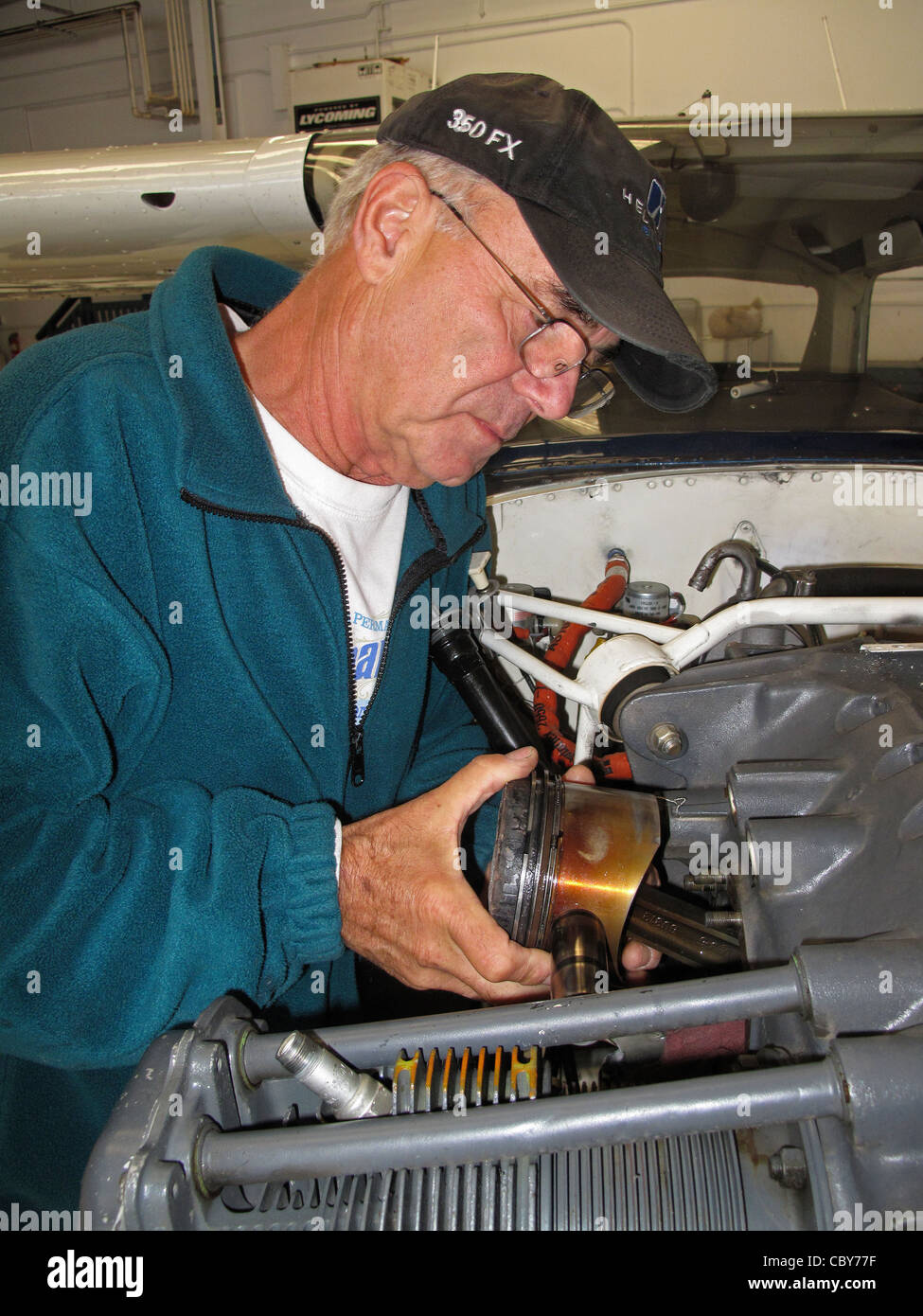 aircraft mechanic Gary Price replaces a cylinder single engine airplane - Stock Image
