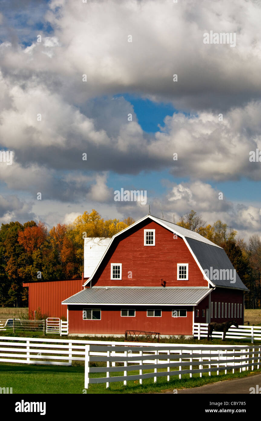 Red Barn, White Fence and Autumn Color in Jennings County, Indiana - Stock Image