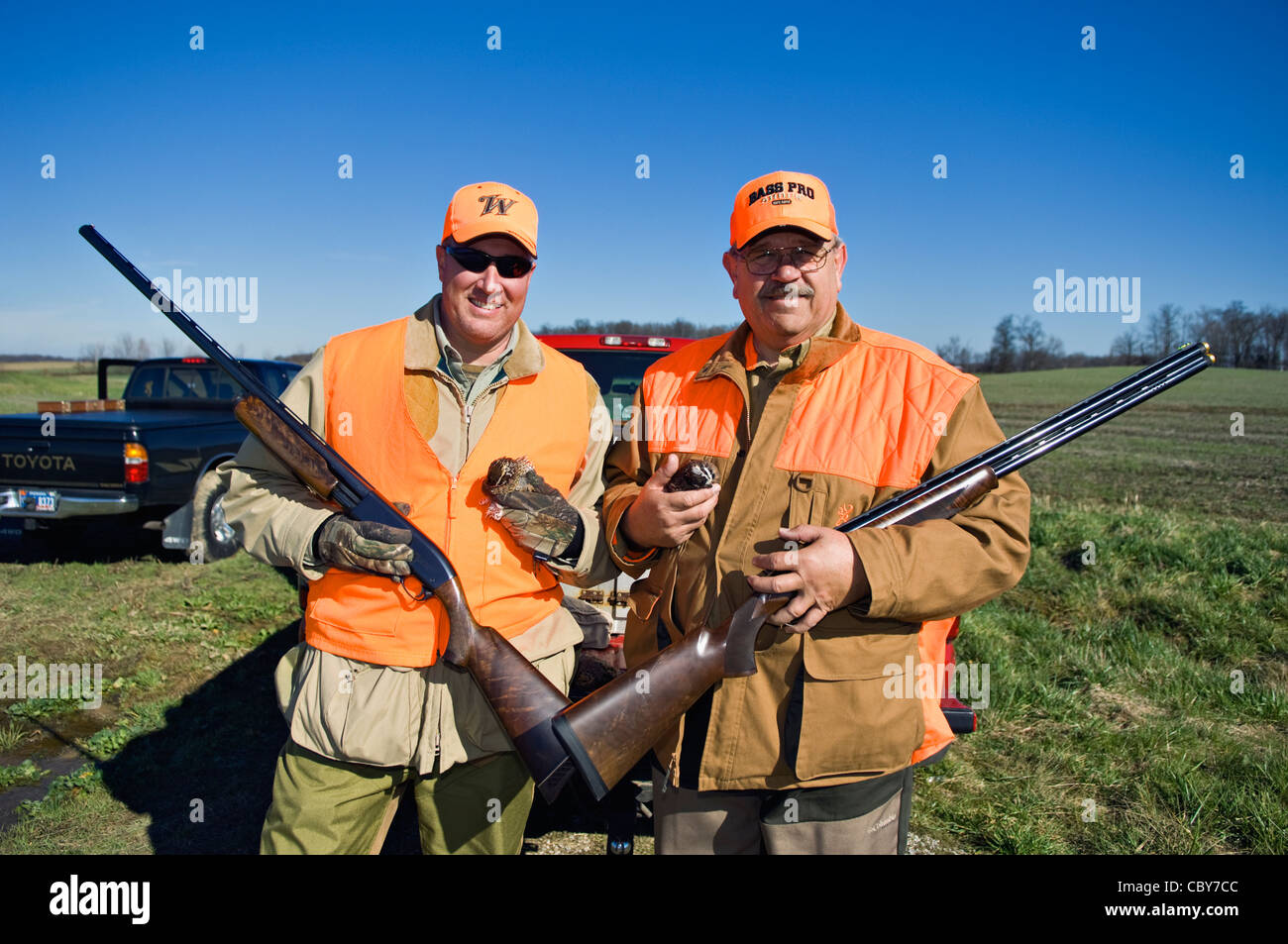 Two Upland Bird Hunters Posing with Shotguns and Bobwhite Quail - Stock Image