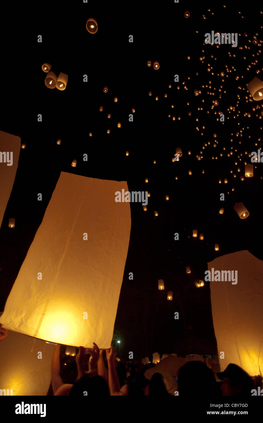 Traditional fire lanterns being released into the night sky during the Loi Krathongfestival in Chiang Mai, Thailand, Stock Photo
