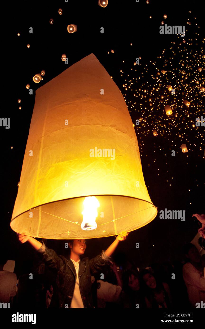 Traditional fire lanterns being released into the night sky during the Loi Krathongfestival in Chiang Mai, Thailand, - Stock Image