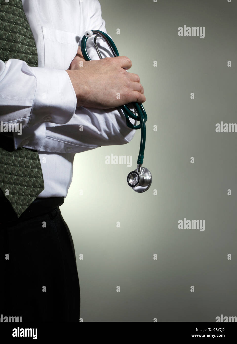 Doctor with stethoscope in Hand - Stock Image