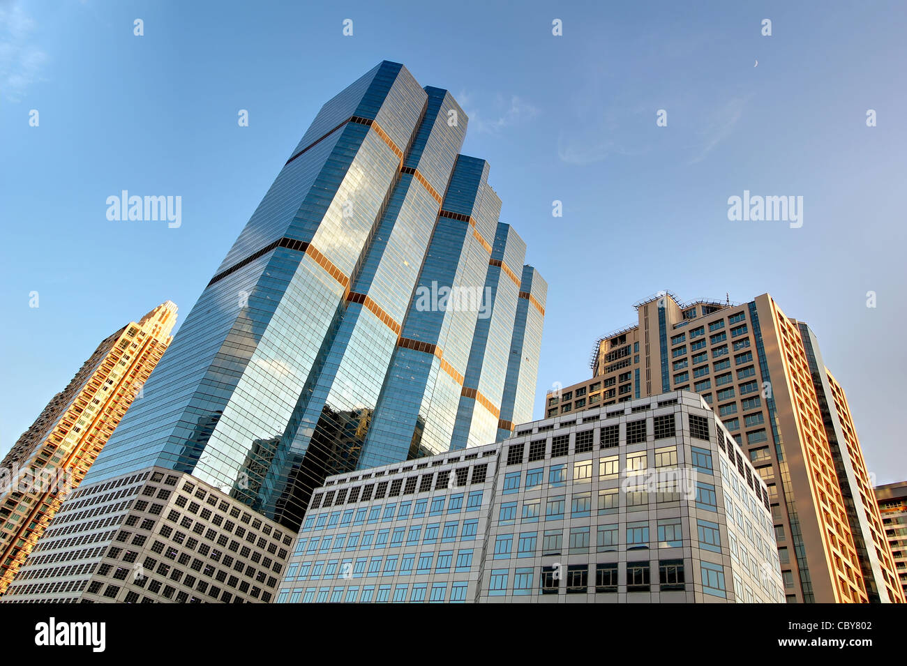 Tightly packed towers (Empire Tower in Center) in Bangkok's Sathorn Road business & financial district. - Stock Image