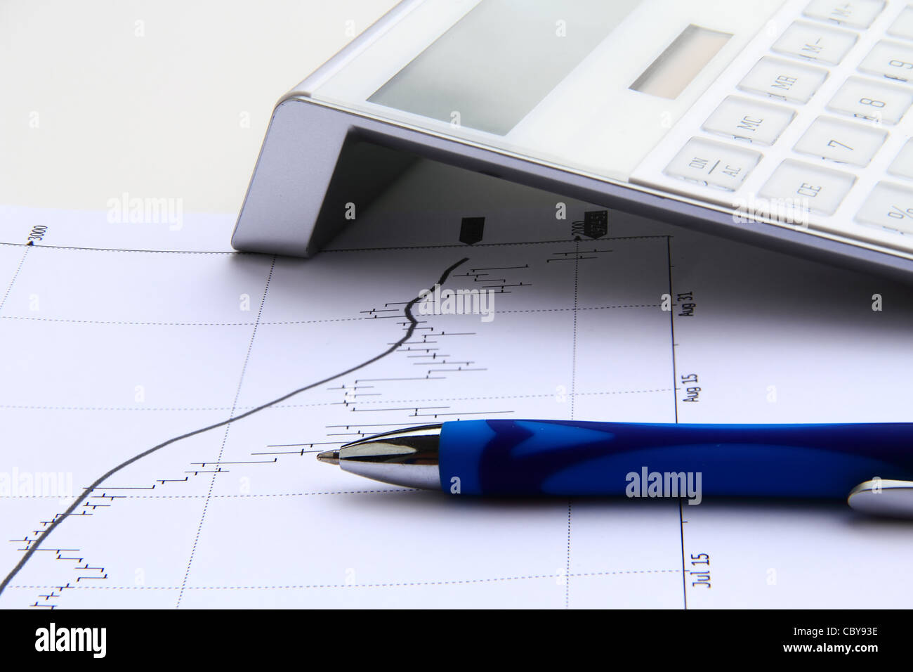 financial chart with solar calculator and blue pen - Stock Image