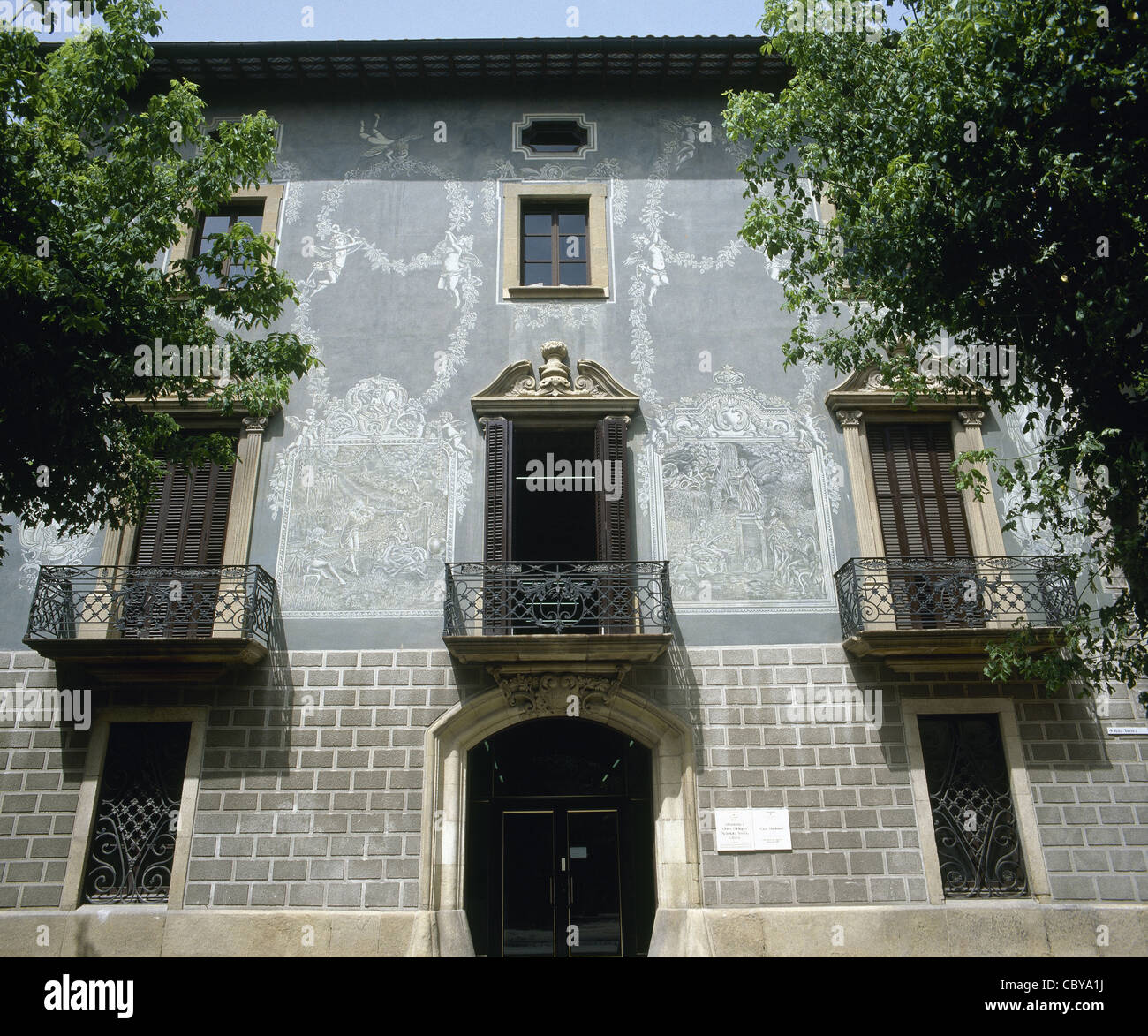 Spain. Vic. House Masferrer. 19th - 20th centuries. Facade with graffiti. - Stock Image