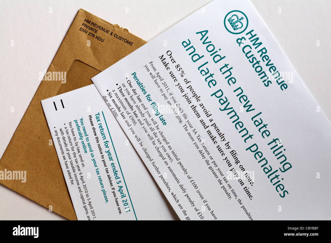 Reminder letter from HM Revenue & Customs warning of penalty fines for late return for tax return on white background Stock Photo