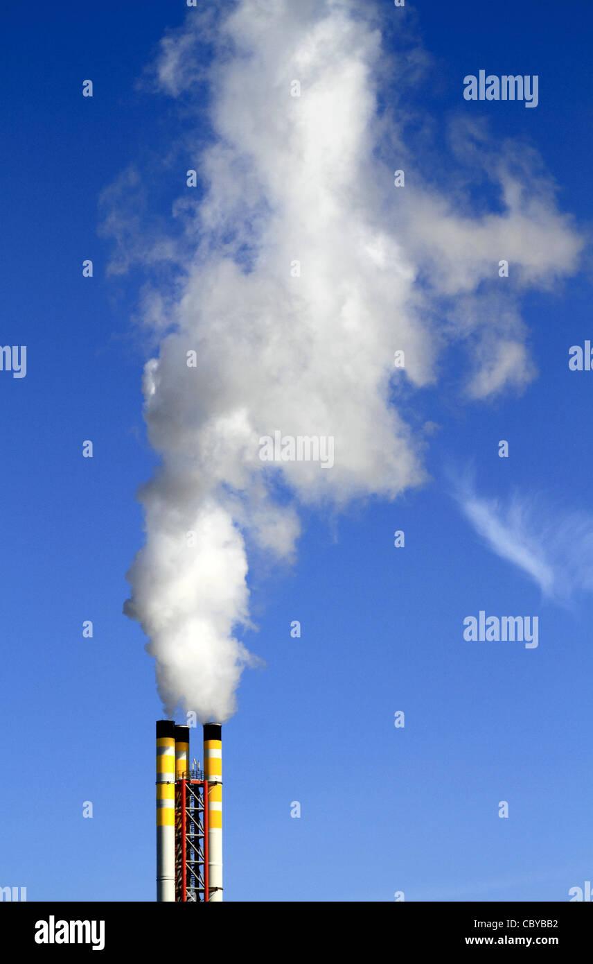 Chimney from a refuse incinerator emitting smoke Stock Photo