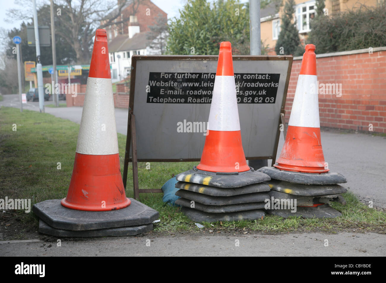 Stacked traffic cones at roadworks - Stock Image