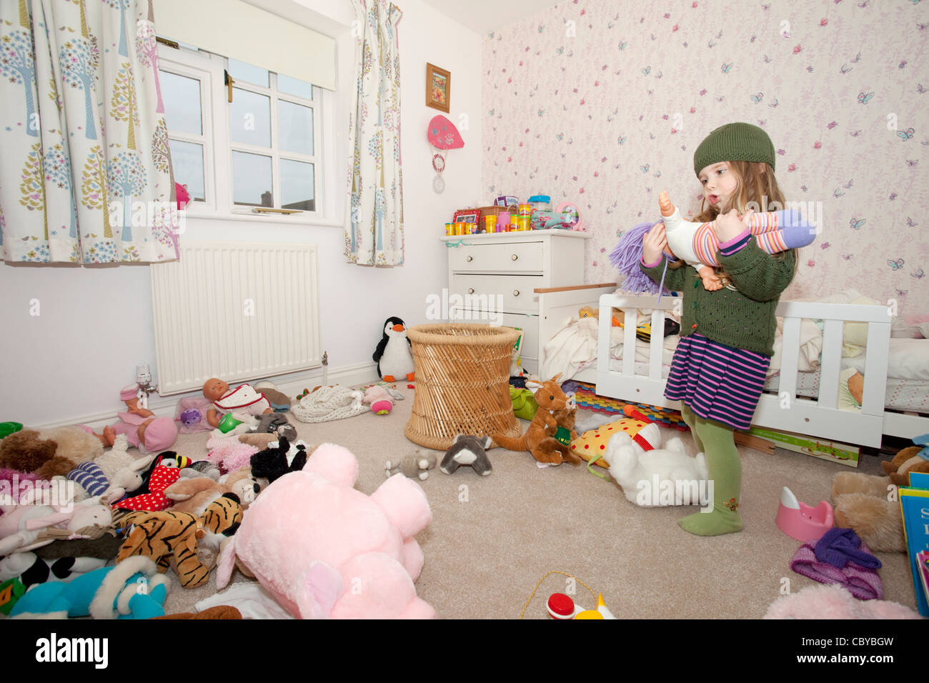 female toddler playing in her bedroom - Stock Image