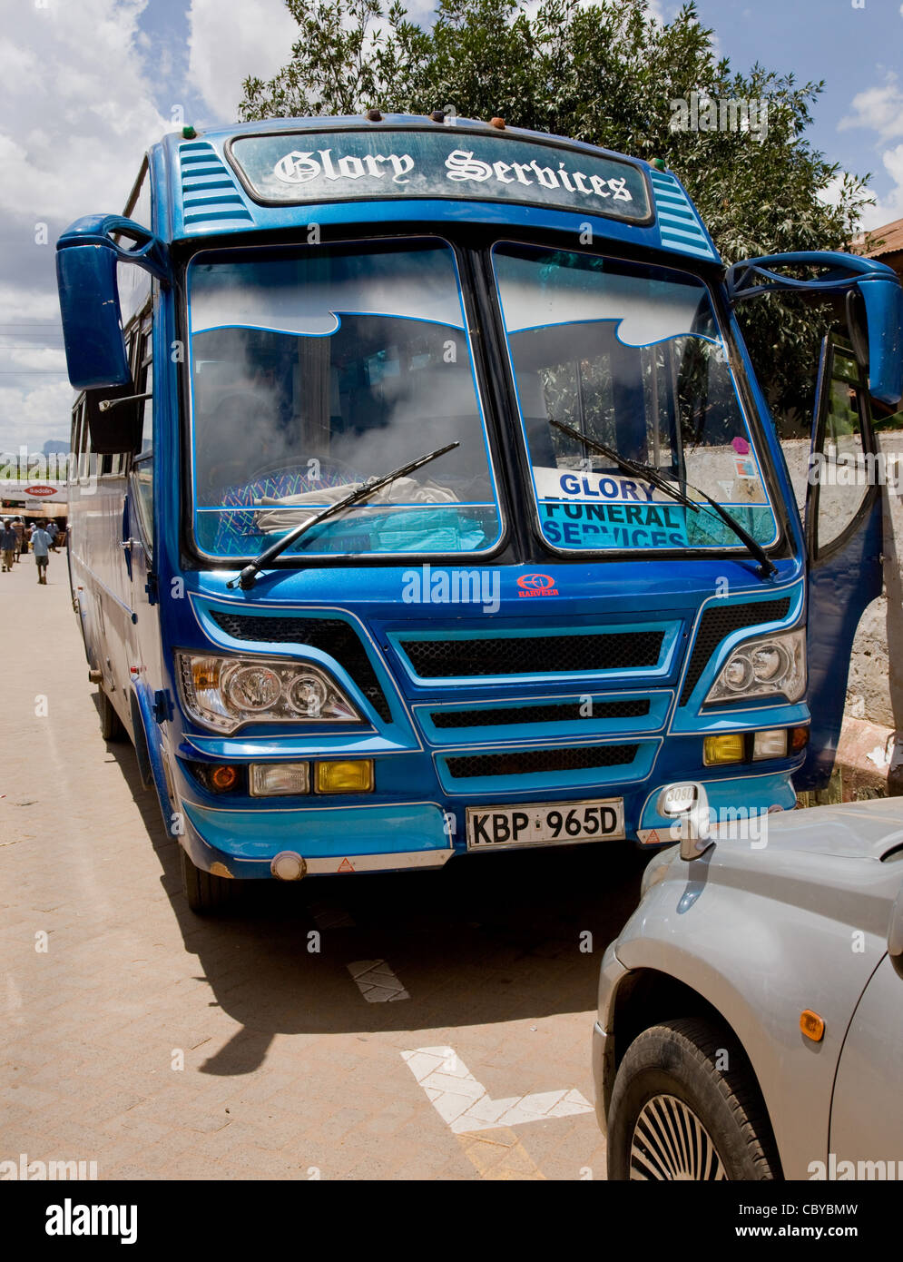 Glory Funeral Services bus in a street in Voi in southern Kenya - Stock Image
