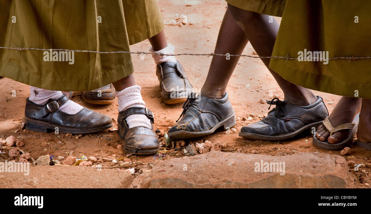 Feet of Kenyan school girls outside the head teacher's office at a school in Voi in southern Kenya Stock Photo