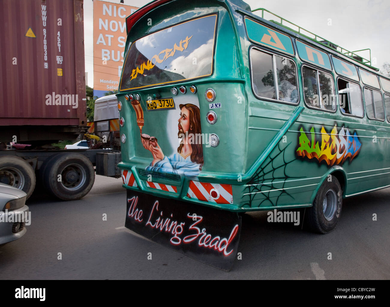 Jesus bus in a traffic jam in central Nairobi in Kenya bears an image of Christ and The Living Bread mudflap - Stock Image
