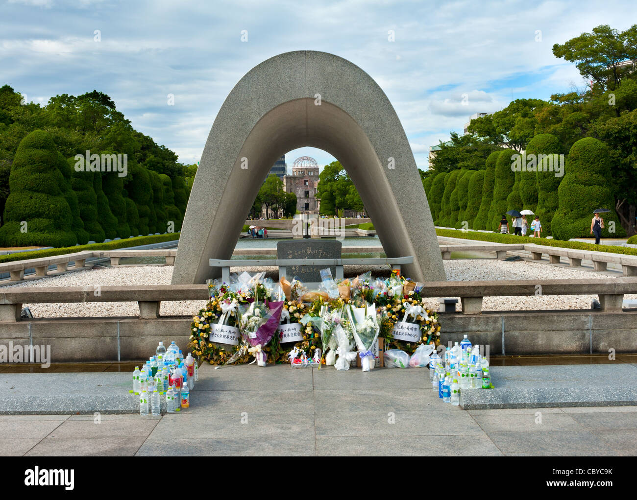 Hiroshima atomic bomb memorial near the spot of the nuclear blast. The Atomic Dome (peace memorial) is visible through - Stock Image