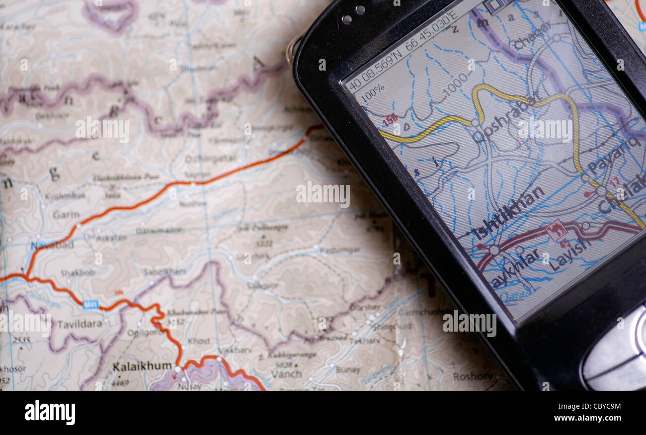 GPS and a paper map - Stock Image