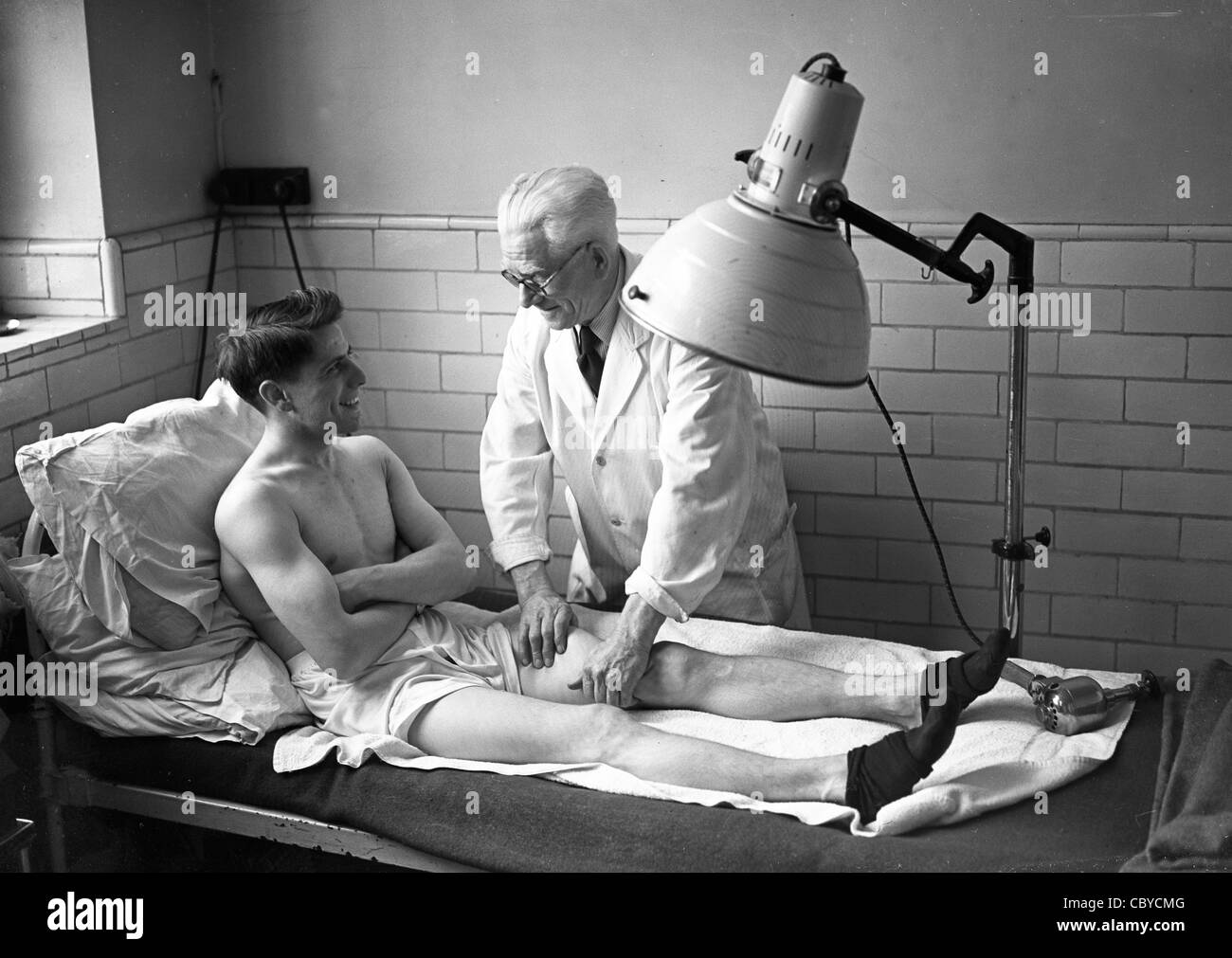British featherweight boxer Thomas 'Tommy' Nicholls with his physiotherapist in 1952 he went on to win Silver - Stock Image