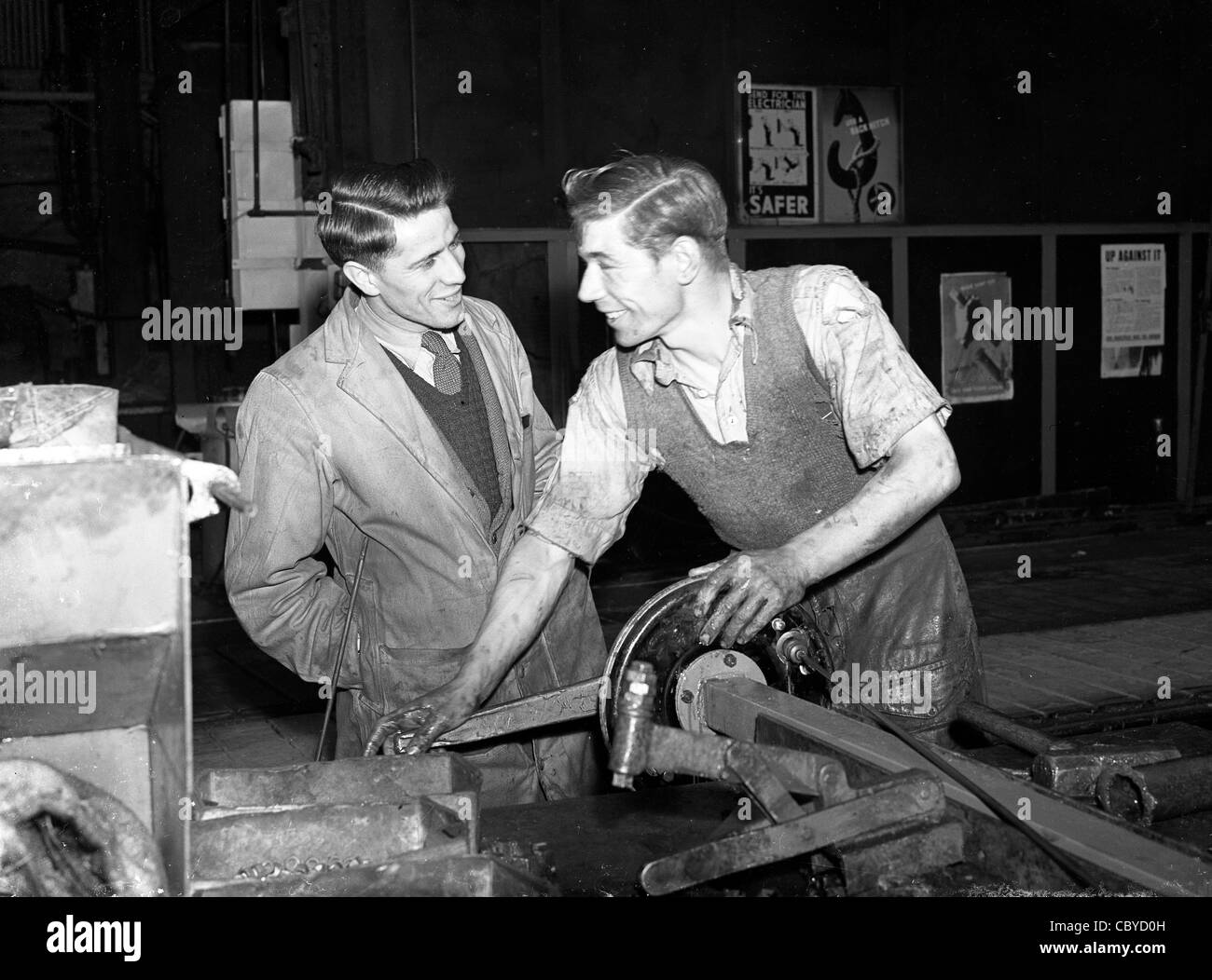 British featherweight boxer Thomas 'Tommy' Nicholls with a factory workmate in 1952 he won Silver at 1956 - Stock Image