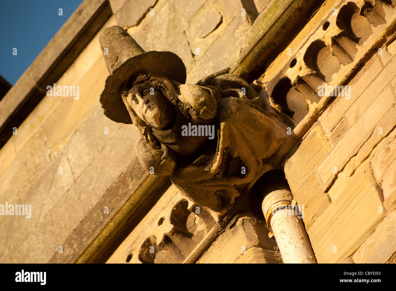 Old Welsh Woman carved gargoyle on the exterior of Old College, Aberystwyth University, Wales UK - Stock Image