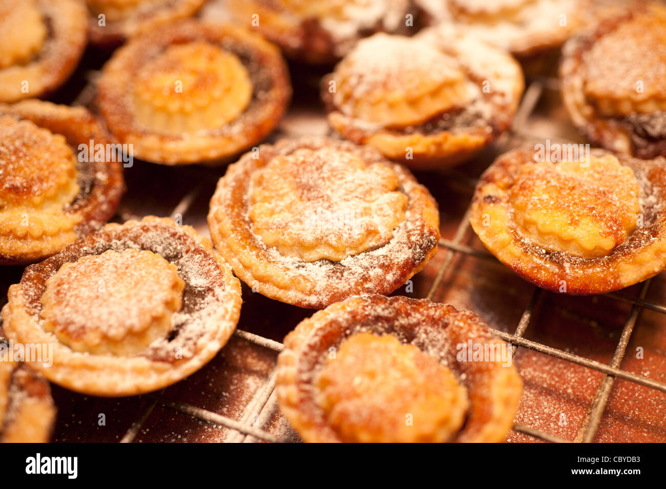 freshly baked Home made mice pies cooling on a rack, UK - Stock Image