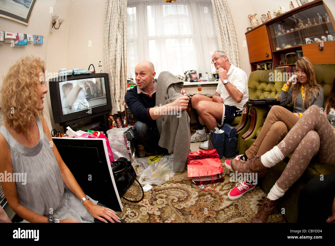 Christmas day 2011, A family unwrapping their presents. uk - Stock Image