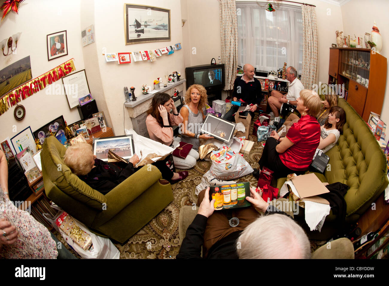 Christmas day, A family unwrapping their presents at home on xmas morning 2011 uk - Stock Image