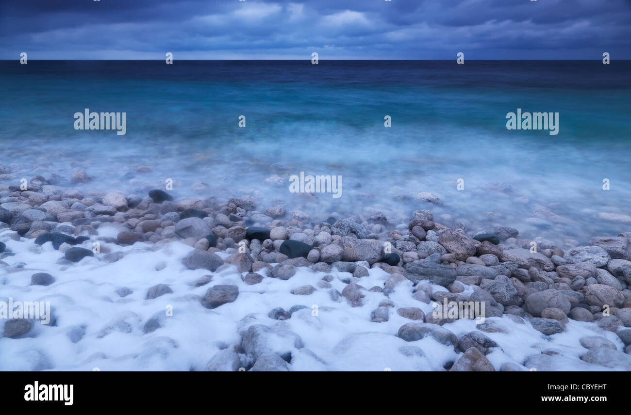 Wintertime scenery of covered with snow pebbles on a shore of Georgian Bay. Bruce Peninsula National Park, Ontario, Canada. Stock Photo