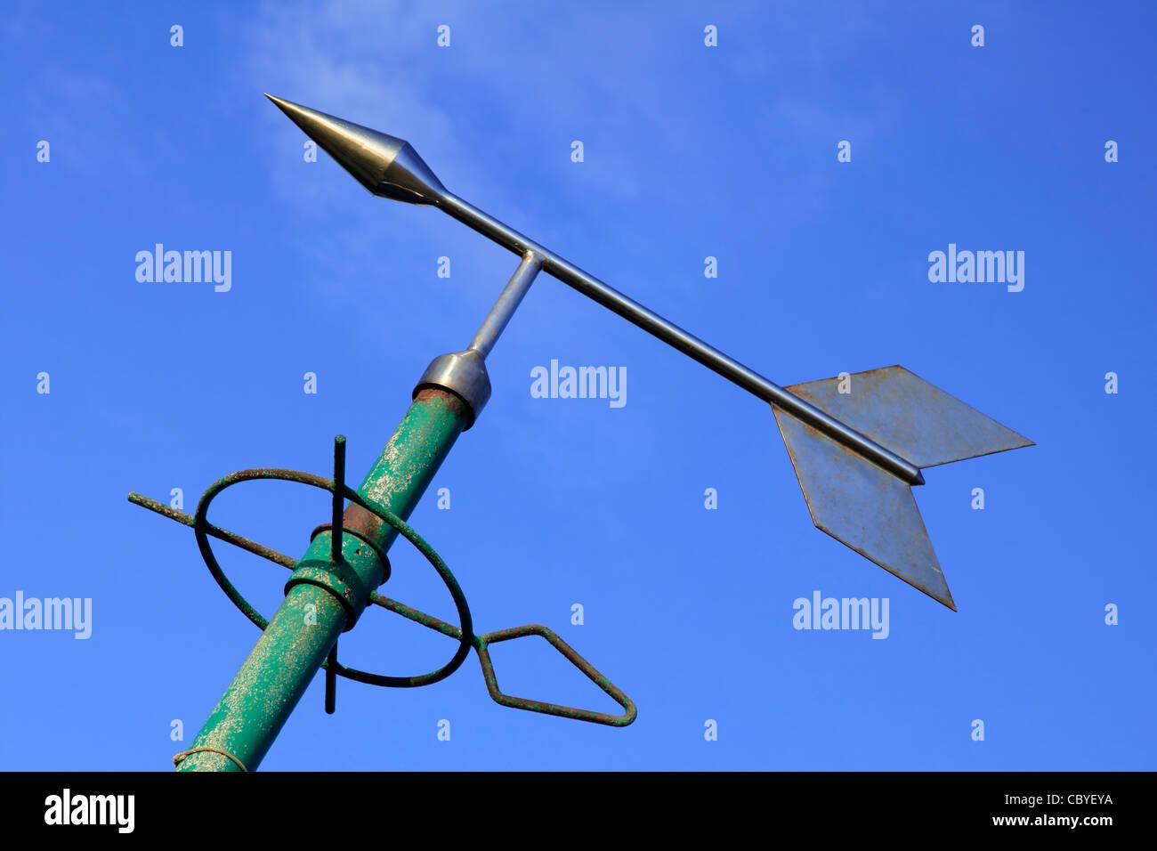 weather vane against blue sky - Stock Image